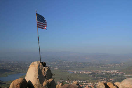 flag posted atop of hill