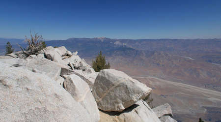 view of desert valley from mountain peak