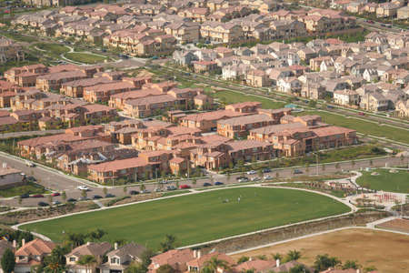 aerial view of houses and field Imagens