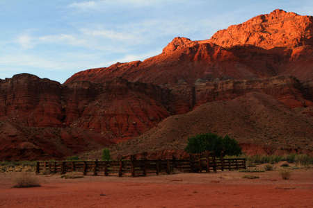 old corral in the desert at sunset