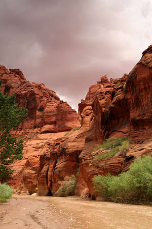 gray storm clouds hang over desert cliffs in southern Utah