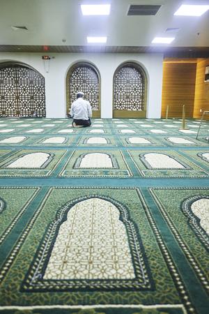 Dhaka, bangladesh, august 2017- a muslim man praying at inside of a mosque located at bodhundhora in dhaka in bangladesh taken on 24 august 2017.