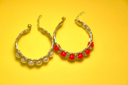 top view of Jewel of red and white pearls isolated with yellow Stock Photo
