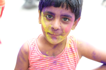 Holi celebrations - Closeup of a child playing Holi in India. Stock Photo