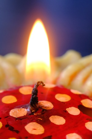 heat loss: A candels with background of dark and bokeh. Stock Photo