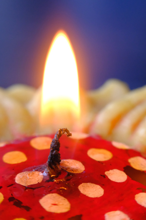 heat loss: Colourful candles with background of dark and bokeh.