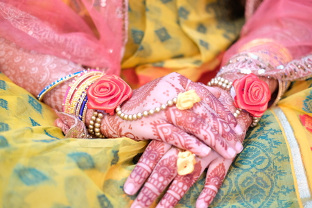 Hindu brides hand painted with mehndi