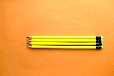 Top view of pensil on orange background
