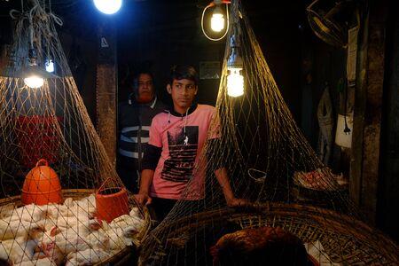 Chicken sellers in local market Standard-Bild - 133648957