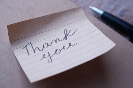 hand written thank you note on paper