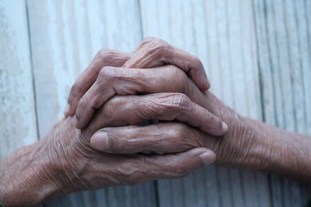 senior women hand on table, 70 years old