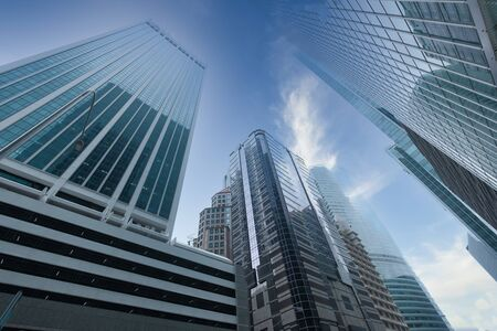 low angle view of Singapore financial buildings in blue sky