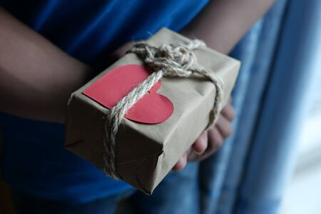 close up of man hand holding valentine day gift.
