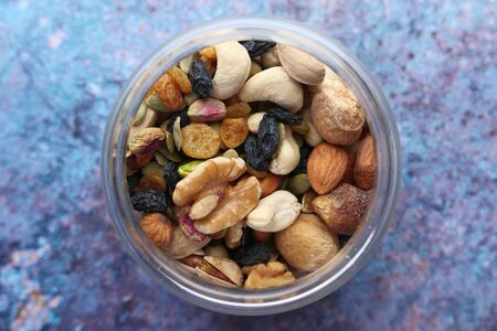 top view of Mixed nut in a jar on table.
