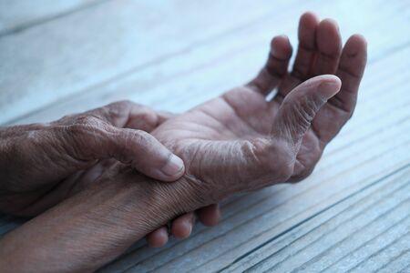 Close up of senior women hand suffering wrist pain Standard-Bild