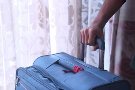 close up of man hand holding luggage for travel Zdjęcie Seryjne