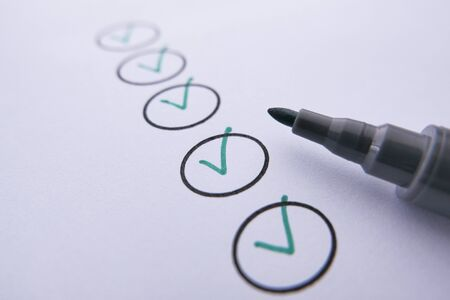 close up of check mark with pen on paper. Reklamní fotografie