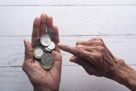 senior women counting coins ,saving money concept