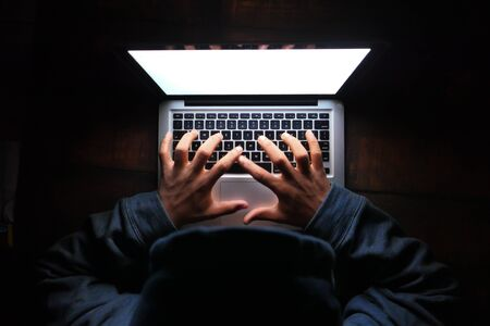 hacker stealing data from laptop, close up . Stock Photo