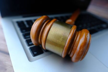 Close up of gavel on laptop, law and security concept