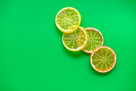 close up of slice of lime on color background. Banco de Imagens