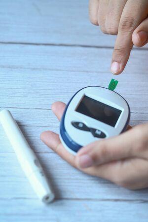 Close up of women hand measuring diabetic indoor.