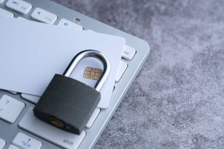 lock and credit card on the computer keyboard