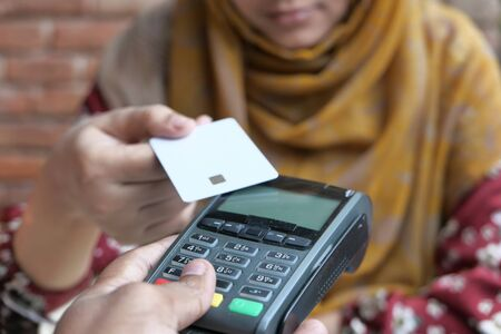 Payment terminal charging from a card, close up