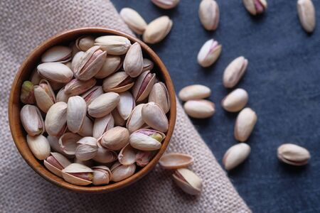 selective focus . Close up of pistachios on hand.