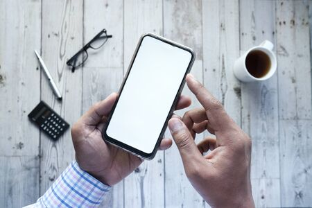man holding smartphone with empty screen, high angle view Stock fotó