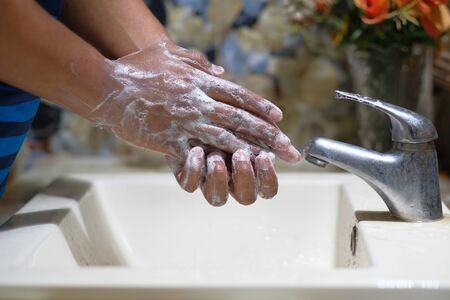 hands with soap warm water using hand sanitizer gel