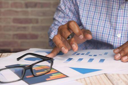 businessman analyzing financial data with copy space