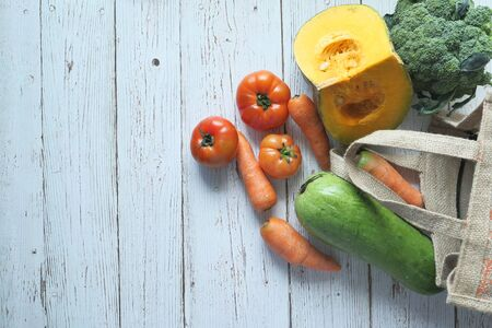 fresh vegetables and shopping bag with copy space