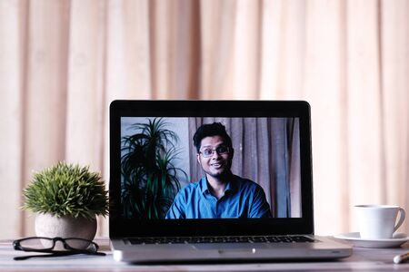 Businessman In a video conference display on laptop screen