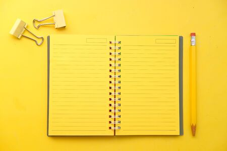 high angle view of yellow color notepad yellow desk