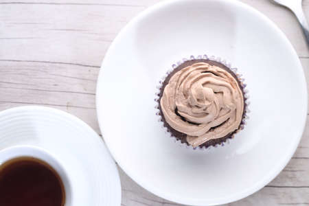 high angle view of cup cake on plate