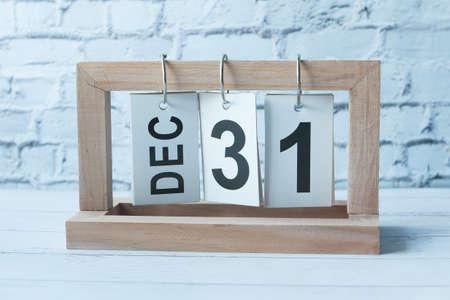 wooden calendar set on the 31 of December