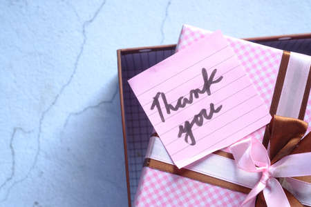 thank you message on gift box on table