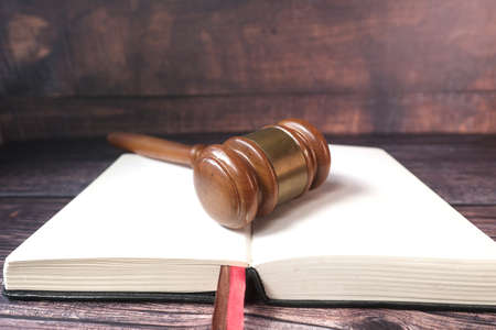 Close up of gavel on a open book with copy space