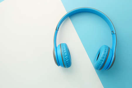 top view of headphone on color background.