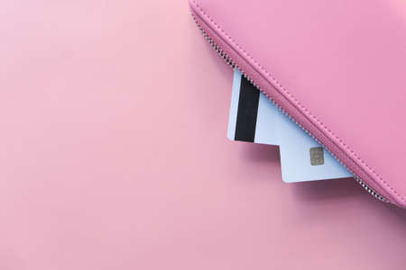 credit cards and wallet on pink background