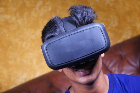 young man wearing virtual reality headset, vr box.