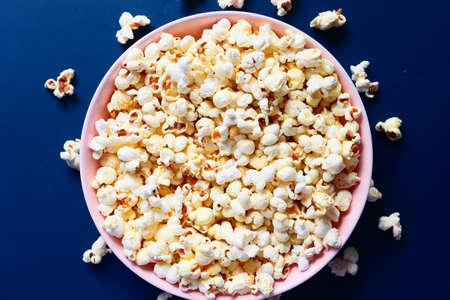 popcorn in a bowl on wooden desk