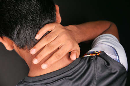 man suffering from neck or shoulder pain at home. Banque d'images