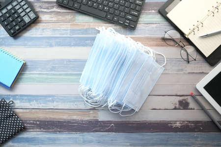Close up of blue surgical masks on office deks