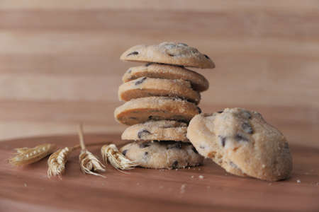 stack of chocolate cookies on wooden background