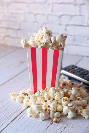 high angle view of popcorn and Tv remote on table