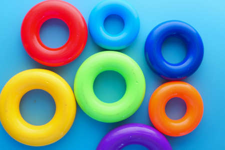Baby toys on color background. Child development concept.
