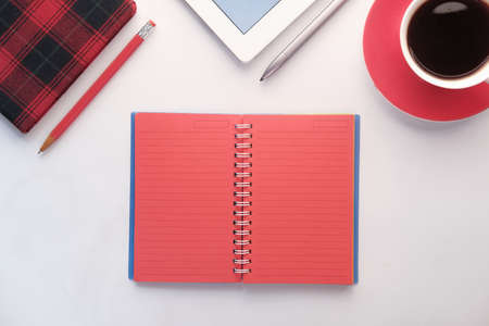 open notepad with stationary on white background