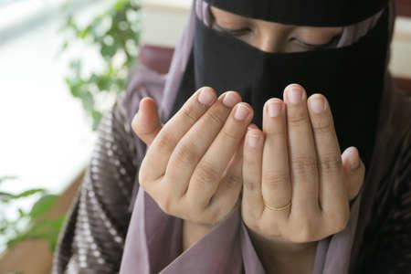 Close up of muslim women hand praying at ramadan